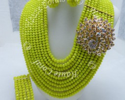 tribal accessories, tribal glam, tribal jewelry, crystal statement necklace, layered statement necklace, bib statement necklace, statement necklace under 100, vintage statement necklace, beaded statement necklace, african accessories, unique statement necklace, beaded statement necklace, african accessories, brooch necklace, yellow statement necklace, crystal statement necklace, peacock brooch, ulochi, Yellow Crystal Beads Statement Necklace, Multistrand Beaded necklace, statement necklace, Nigerian Wedding beads, nigerian engagement beads, Nigerian traditional wedding beads, crystal bead necklace, beaded bridal necklace, purple statement necklace, nigerian coral beads, rhinestone brooch, rhinestone necklace, brooch necklace