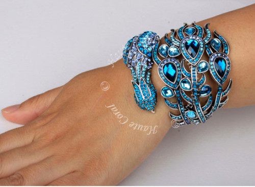peacock bracelet, peacock cuff, peacock statement cuff bracelet,tribal accessories, tribal glam, tribal jewelry, crystal statement bracelet, silver statement bracelet cuff, vintage statement bracelet, beaded statement bracelet, african accessories, unique statement bracelet cuff, rhinestone bracelet, african accessories, statement bracelet, Nigerian Wedding beads, nigerian engagement beads, Nigerian traditional wedding beads, statement cuff, leaf bangle, leaf bracelet cuff,